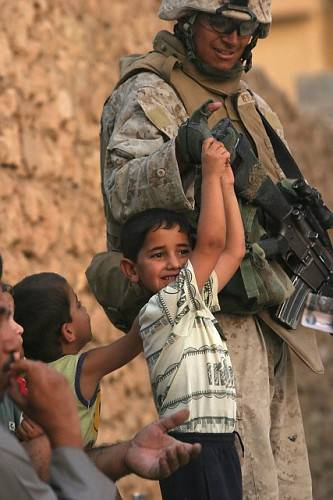 Soldier_forces_child_to_hang_by_fingerti