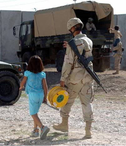 Soldier_forces_child_to_work